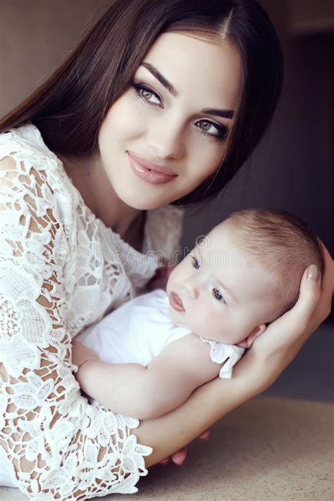 Beautiful Mother With Luxurious Dark Hair And Her Little
