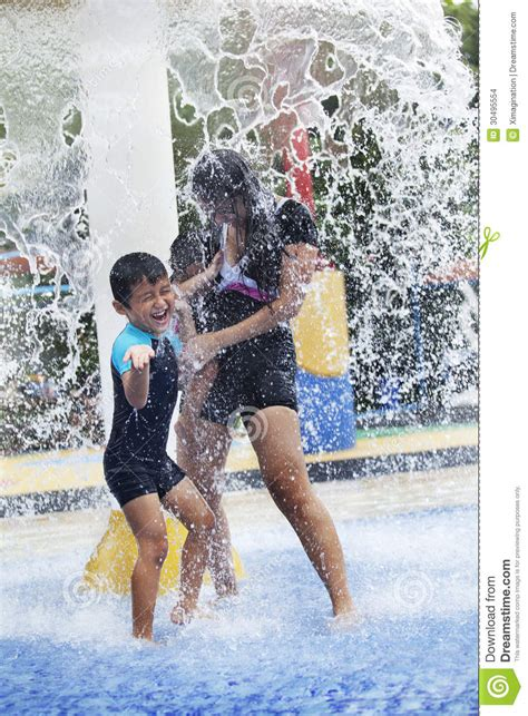Family Having Fun In Water Park Stock Images - Image: 30495554